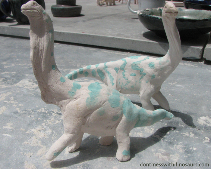 Brachiosaurs with copper carbinate stain (bisque-fired white stoneware)